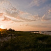 Title: Over the Dunes<br /> Date: August 2011<br /> Cape Cod MA - Sunset over Sesuit Harbor in Dennis MA.