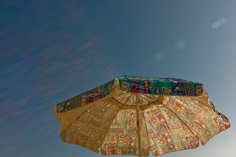 Title: Beach Umbrella<br /> Date: August 2009<br /> Cape Cod MA - A beach umbrella in the summer sun.
