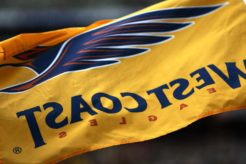 A proud West Coast Eagles (AFL football) fan waves a flag in their game against Hawthorn at the MCG.