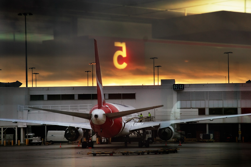 A plane being readied for the day ahead at dawn.  Melbourne airport.