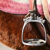 Saddle stirrup on a pony in Lijang, China.