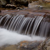 A cascade in the stream running alongside Hellbrook trail in Smuggler's Notch, Vermont.