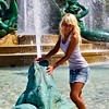 A girl poses in a fountain in Philadelphia.