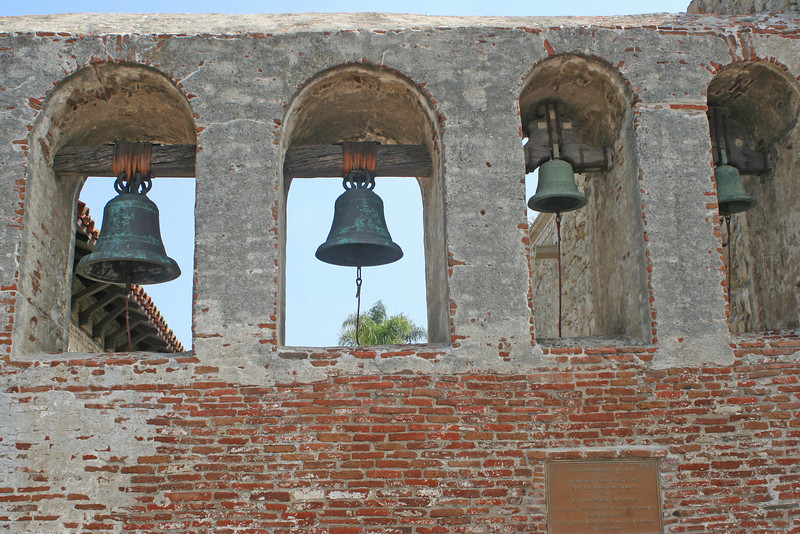 """6/30/10 Bell Wall.   From the brochure: """"The bells originally hung in the bell tower of the Great Stone Church until the earthquake of 1812. The two large bells are recast of the original that date back to 1796. The small bells date back to 1804. Bells were important to early Mission life, and called the community to meals, religious services, work, funerals, the sighting of a supply ship or a returning padre and for recreation purposes."""""""