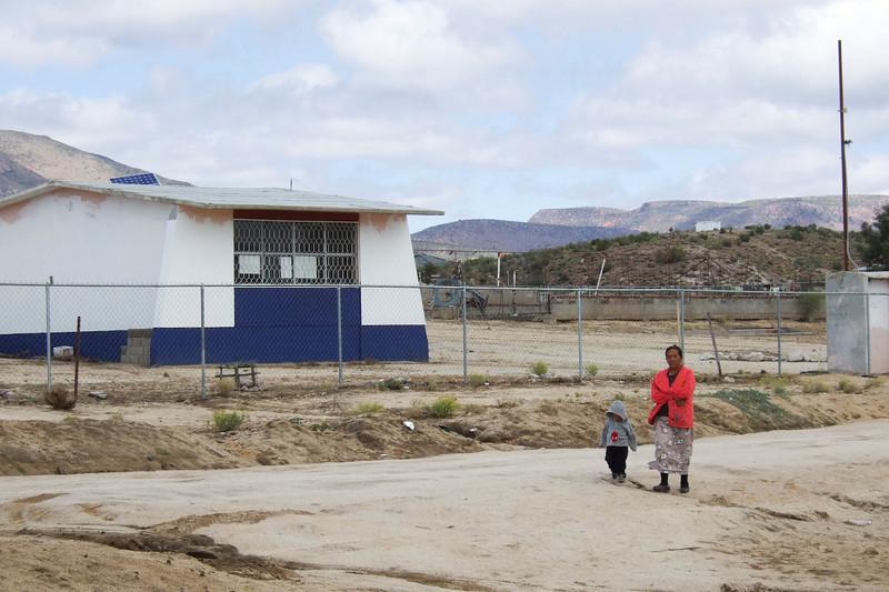 Pei Pei Child in front of school