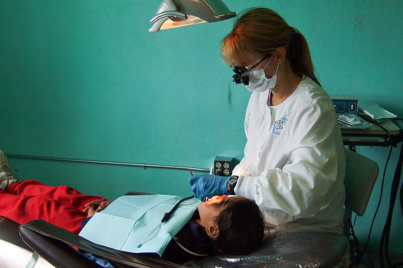 Stacey cleaning teeth