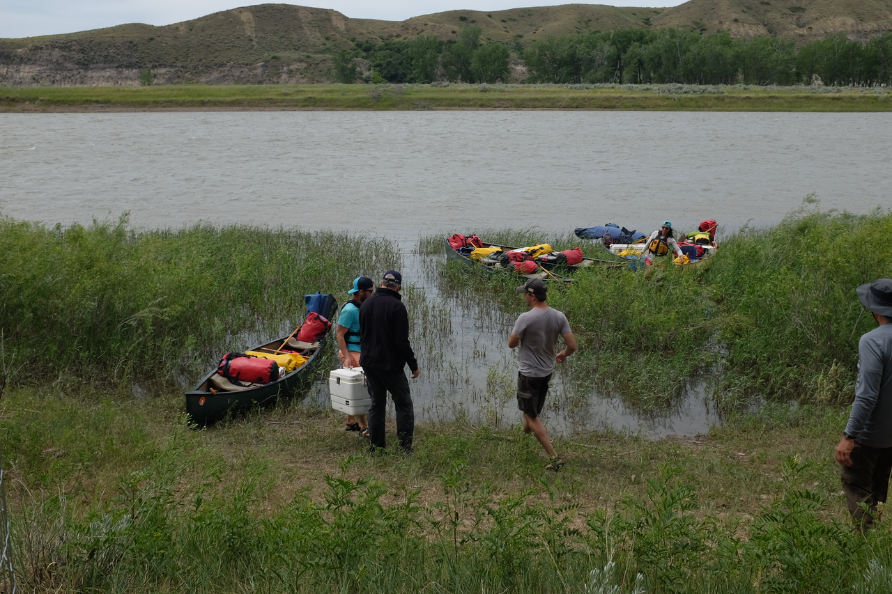 """After several hours, we put in to """"Little Sandy"""", one of the BLM campsites, for a lunch stop. Coolers of food and drink were carried up along with items like folding chairs and tables."""