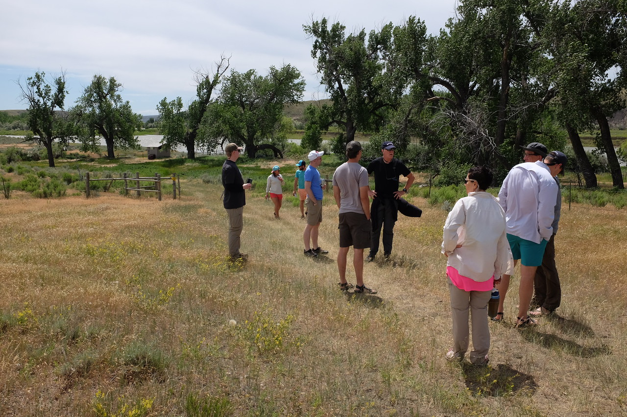 """After lunch was over, we assembled for the first of several hikes during the trip. In the far background, you can see one of the campsite's modern, clean, convenient and fresh, concrete-and-tile toilet building. An unexpected amenity that underscored """"civilized""""."""