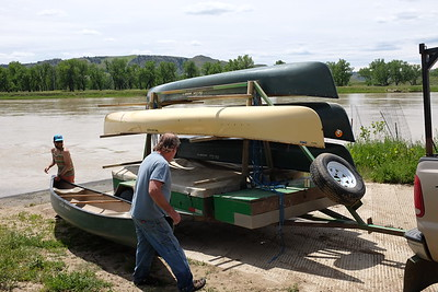 The final canoe is flipped into position.