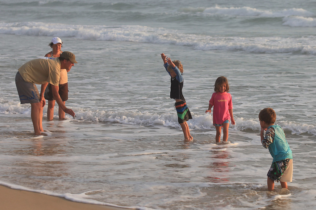 This Dad was doing a good job getting his kids to be athletic stars for the camera - Early morning Broadbeach, 11-12-09
