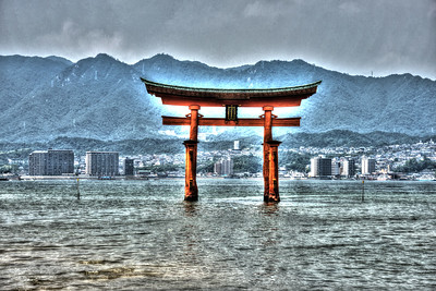 "Itsukushima Shrine (Japanese: 厳島神社 Itsukushima-jinja) is a Shinto shrine on the island of Itsukushima (popularly known as Miyajima), best known for its ""floating"" torii gate. It is in the city of Hatsukaichi in Hiroshima Prefecture in Japan. The shrine complex is listed as a UNESCO World Heritage Site, and the Japanese government has designated several buildings and possessions as National Treasures.  Itsukushima jinja was the chief Shinto shrine (ichinomiya) of Aki Province. The shrine has been destroyed many times, but the first shrine buildings were probably erected in the 6th century. The present shrine dates from the mid-16th century, and is believed to follow an earlier design from the 12th century.That design was established in 1168, when funds were provided by the warlord Taira no Kiyomori. Miyajima (宮島町) is a town located on the island of Itsukushima in Saeki District, Hiroshima Prefecture, Japan."