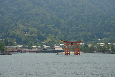 On our way from Hiroshima to Miyajima.  Miyajima (宮島町) is a town located on the island of Itsukushima in Saeki District, Hiroshima Prefecture, Japan.  Hiroshima (広島市) is the capital of Hiroshima Prefecture, and the largest city in the Chūgoku region of western Honshu, which is the largest island of Japan. It is recongnized as the first city in history to be targeted by a nuclear weapon when the United States Army Air Forces (USAAF) dropped an atomic bomb on it at 8:15 a.m. on August 6, 1945, near the end of World War II. Hiroshima is situated on the Ōta River delta, on Hiroshima Bay, facing the Seto Inland Sea on its south side. The river's six channels divide Hiroshima into several islets.