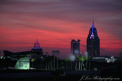 The Mobile skyline at sunset from the causeway just west of Daphne.