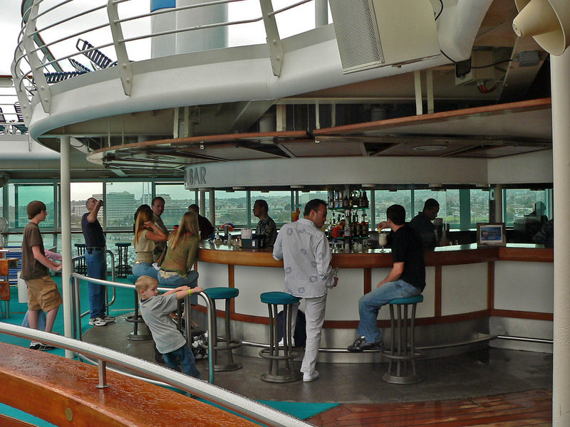 """Pool bar.....see the family at the left? If you read my posts on  <a href=""""http://www.cruisecritic.com"""">http://www.cruisecritic.com</a> you will see they were barely starting to enjoy the day here.....and their kids will need therapy for the rest of their lives!!!"""