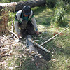 Woodsman building a rake for the grass harvest