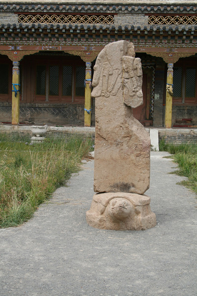 A deer stone displayed outside the museum.