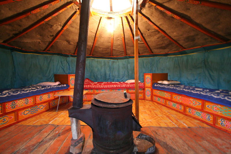 Inside our ger.  Notice the three beds, and the bright colors!