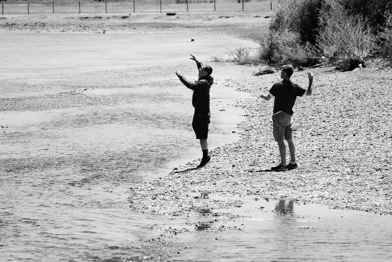 Rocks + water = throwing.