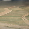 """This is what roads look like on the Mongolian steppe.  They're more """"route suggestions"""" than actual roads.  But they eventually get you to where you want to go."""