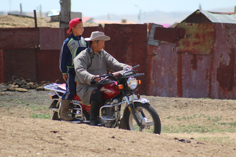 Nyamdorj and he grandson rode out to the arena to check on the start time for the practice race.  I'm not sure it's much quicker by motorcycle, but it sure is more modern.