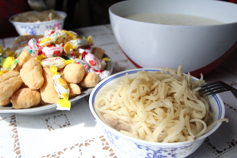 Here's a shot of the bread, yogurt, and noodle soup (with meat).  These are very traditional Mongolian dishes, typical of how the herding families eat.