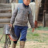 The grandson helps to prepare his horse for the practice race.