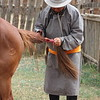 Nyamdorj prepares the horse to practice racing portion of the Naadam festival in their village.