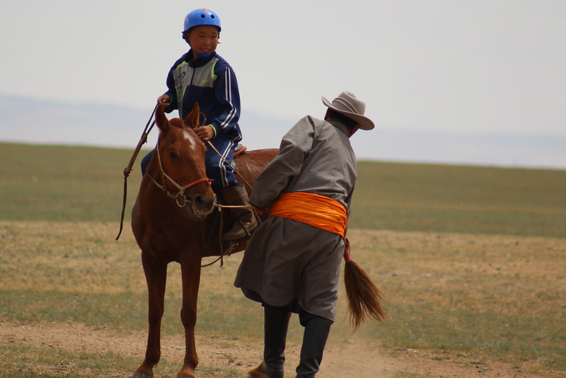 Afterwards, Nyamdorj went to help his grandson bring his horse back in.  It was cute to see how proud the grandson was throughout the whole event.  Can you imagine?  What a total thrill!