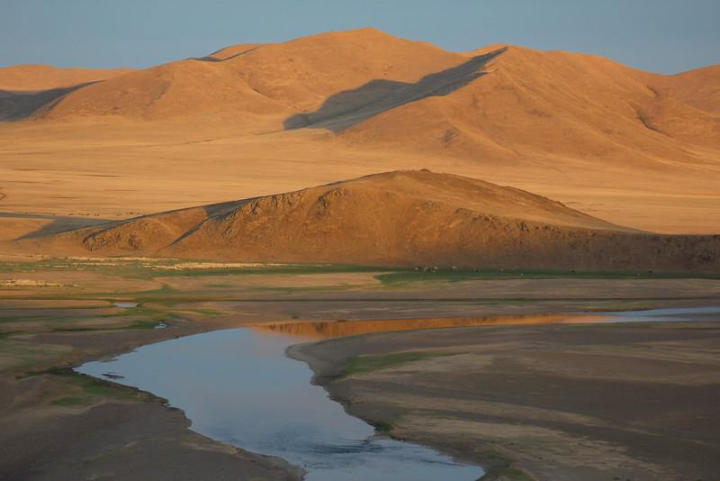Love the golden light on the hills.  Mongolia, or Wyoming?  I'll never tell...