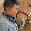 Even though horses (and other animals) are not considered pets in Mongolia, I couldn't help but see this as a tender moment between the grandson and his horse.