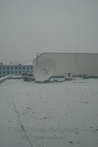 Satellite antenna covered by snow and ice. Ulaanbaator, Mongolia.
