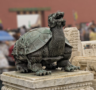A bronze turtle in front of the Hall of Supreme Harmony, symbolizing longevity.