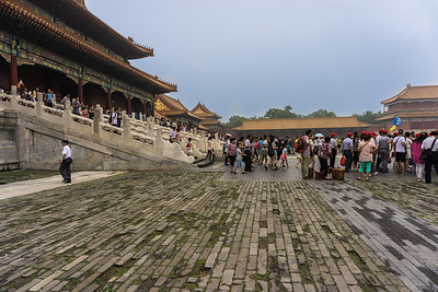 Crowds entering and leaving the Forbidden City at the Gate of Supreme Harmony
