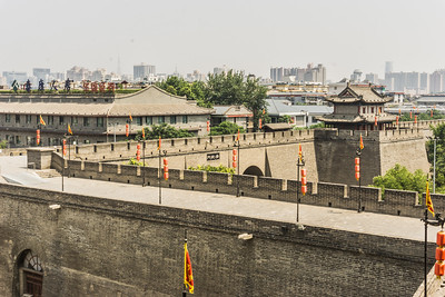 Xi'an city wall which is the most complete city wall that has survived in China, as well being one of the largest ancient military defensive systems in the world.  It was expanded by Zhu Yuanzhang, the first Emperor of the Ming Dynasty (1368-1644) so that he could fortify the city and unify the other states. After the establishment of the Ming dynasty, Zhu Yuanzhang began to enlarge the wall built initially during the old Tang Dynasty (618 - 907), creating the modern Xian City Wall.