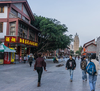 On Nanping pedestrian street in Kunming.  The new government building is the background.