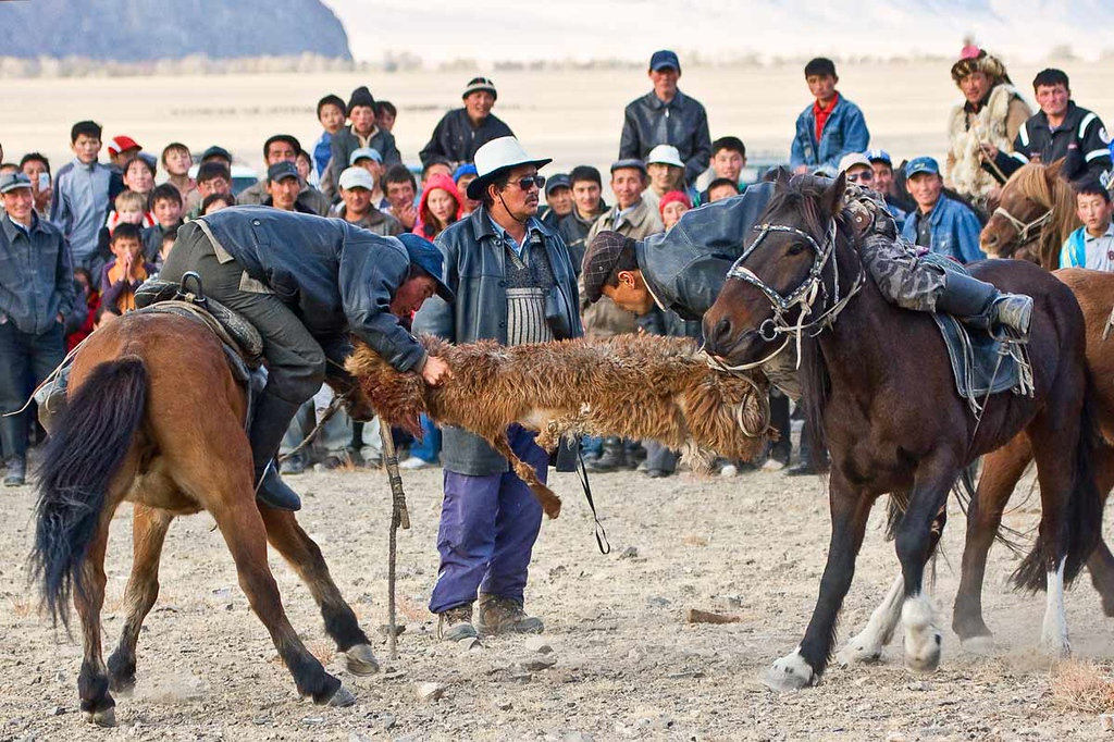 Tug of war using sheep's skin. Very serious and violent game.
