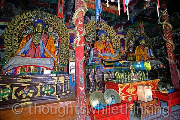 Mongolia 2008 Inside the temple to the West, Baruun Zuu, are Dipamkara (Sanjaa), the Past Buddha (left), adult Buddha Sakyamuni (center), Maitreya (Maidar), the Future Buddha (right). Erdene Zuu Monastery. Central Mongolia August 26