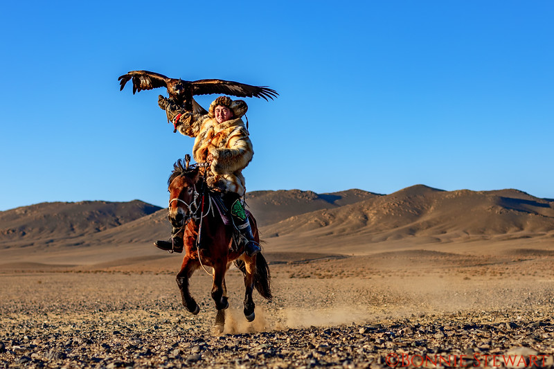 Guna, Mr. Sailou's son, running with his eagle on his  horse