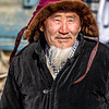 Family patriarch and former eagle hunter coming to watch the Altai Nomad Games with his family
