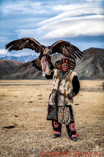 Mr. Ardak winnier #2 of the Eagle Hunter competition in the Altai Nomad Games!   He put the winning medal on his eagle for this photo!