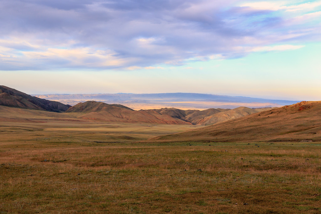 Sunset painting the rolling hills of Uvs Province.