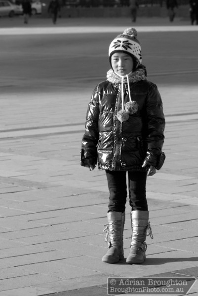A girl poses for a photo in the main square in Ulaanbaatar, Mongolia.