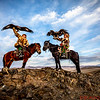 Mr. Sailou and his son Guna on horses with their Eagles