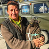 Mr. Bashakhan holding his  eagle wrapped for transport ready to drive to the Altai Nomad Games 2018.