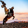 Guna, Mr. Sailou's son,  on horse back, Kazakh Eagle Hunter