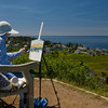 A local artist paints from the grounds of the Monhegan Island Lighthouse.