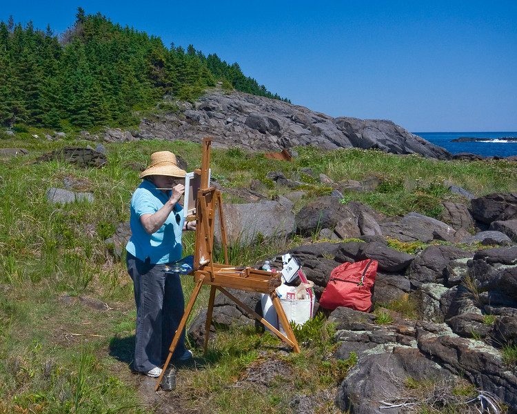 Artist painting the shipwreck at Lobster Cove on Monhegan Island, Maine.