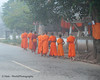 "Lao Monks Head Off In the Morning Mist On Their Daily Alms Walk - ""Tak Bart"", Ban Khone, Luang Nam Tha Province, Lao People's Democratic Republic"