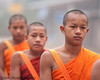 "Lao Monks In the Morning Mist On Their Daily Alms Walk - ""Tak Bart"", Ban Khone, Luang Nam Tha Province, Lao People's Democratic Republic"