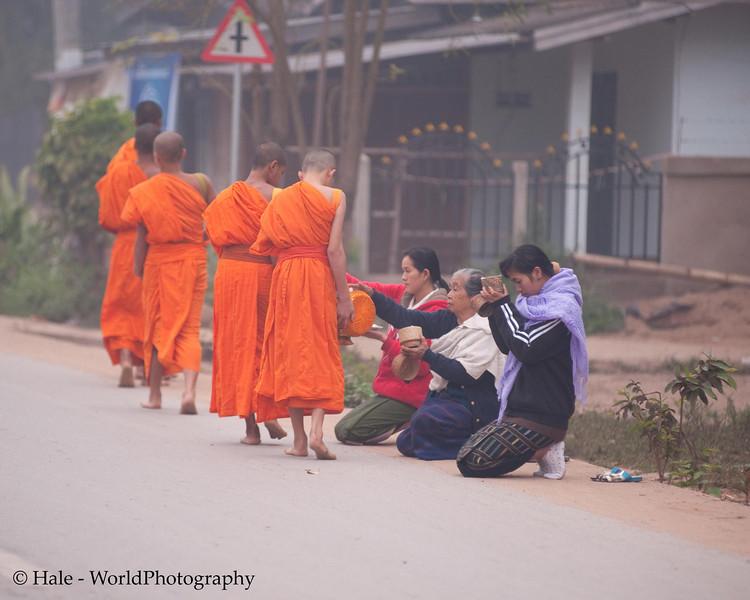 "Ban Khone Villagers Making Merit, ""Tum Boon"", By Giving Food to Monks, Ban Khone  Luang Nam Tha Province, Laos"